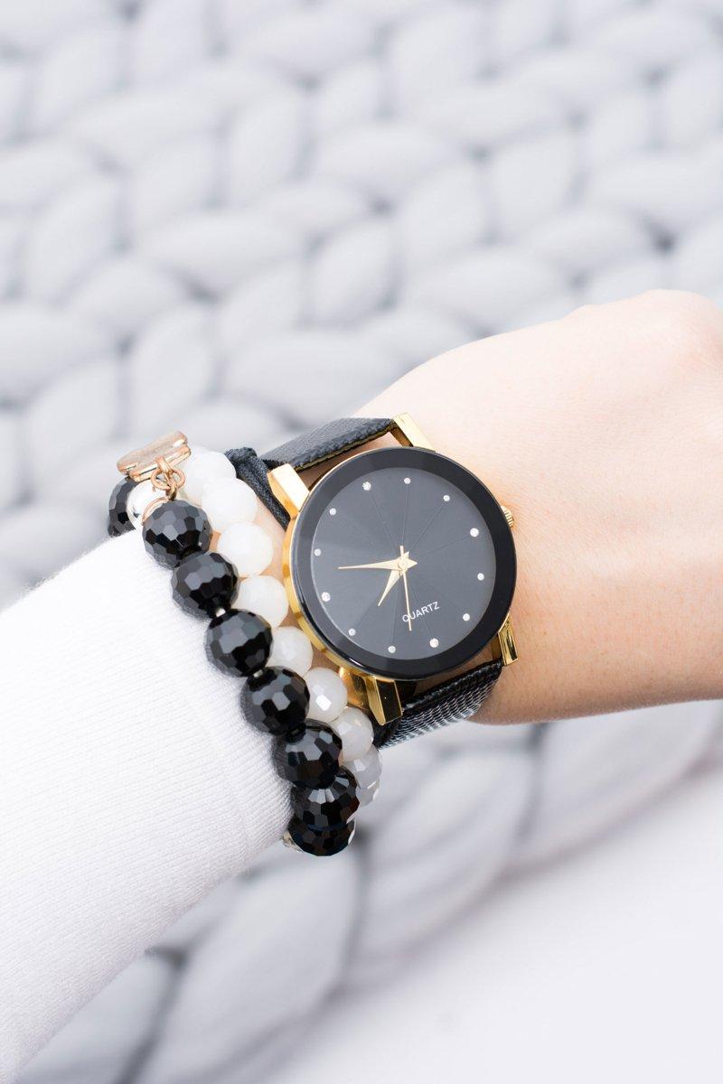 Elegant Ladies Black and Gold Watch on Belt